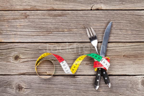 Zdrowa żywność widelec nóż centymetrem drewniany stół górę Zdjęcia stock © karandaev