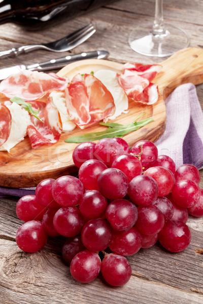 Grape, prosciutto and mozzarella with red wine Stock photo © karandaev