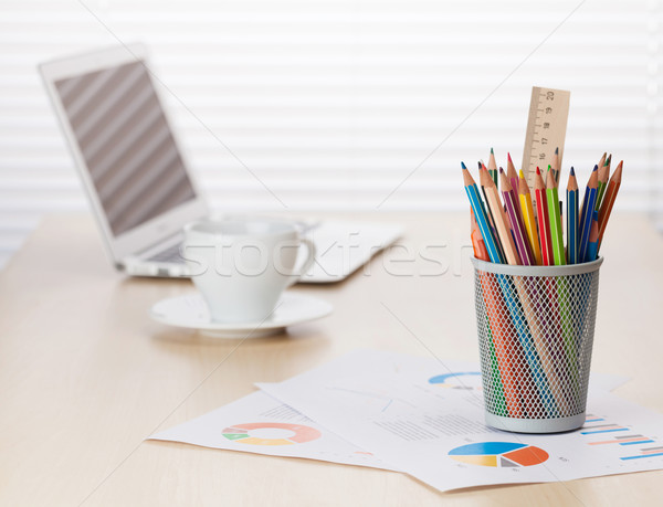 Office desk workplace with laptop, coffee and pencils Stock photo © karandaev