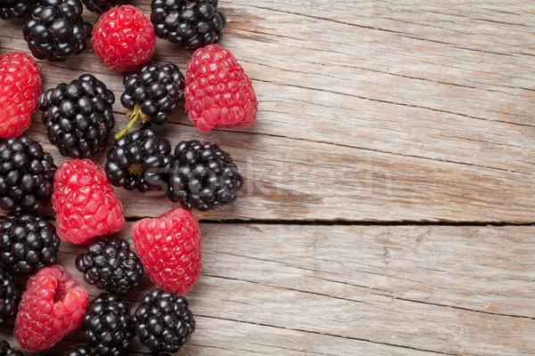 Blackberries and raspberries on wooden Stock photo © karandaev