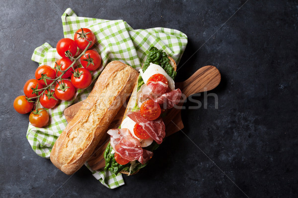 Sandwich with salad, prosciutto and mozzarella Stock photo © karandaev