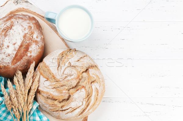 Stock photo: Homemade crusty bread and milk