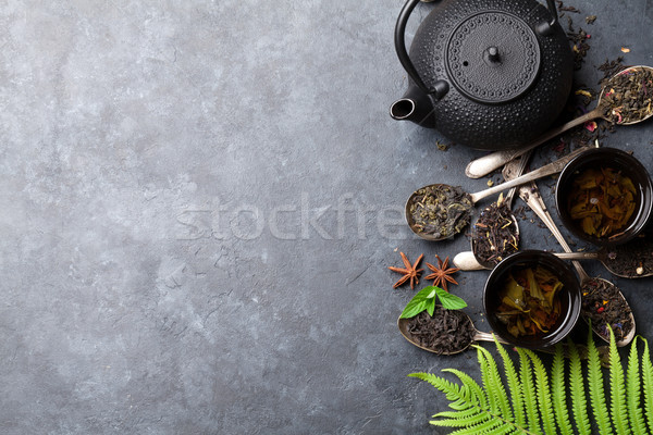 Various tea in spoons and teapot. Black, green and red tea Stock photo © karandaev