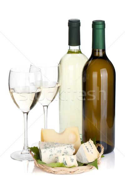 White wine bottles, two glasses and cheese Stock photo © karandaev