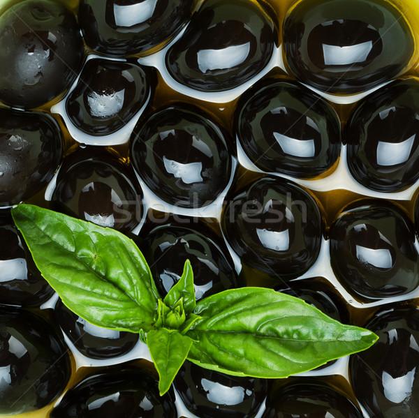 Siyah zeytin fesleğen zeytinyağı gıda arka plan yaprakları Stok fotoğraf © karandaev