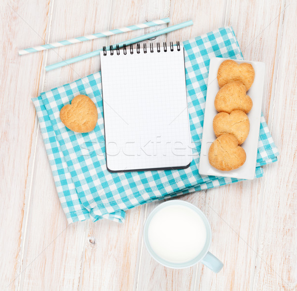 Kubek mleka serca cookie notatnika Zdjęcia stock © karandaev