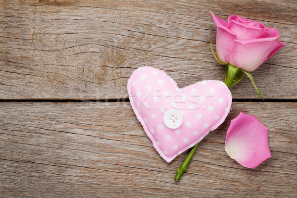 Valentines day background with pink rose and handmaded toy heart Stock photo © karandaev