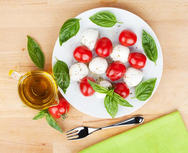 Caprese salatası plaka ahşap masa gıda arka plan yağ Stok fotoğraf © karandaev