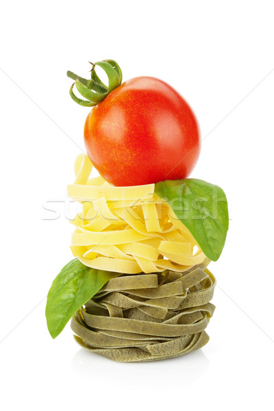 Fettuccine nest pasta with tomato cherry and basil Stock photo © karandaev