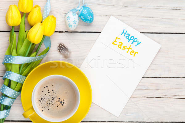 Easter greeting card with blue and white eggs, yellow tulips and Stock photo © karandaev