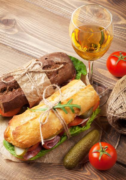 Two sandwiches and white wine glass Stock photo © karandaev