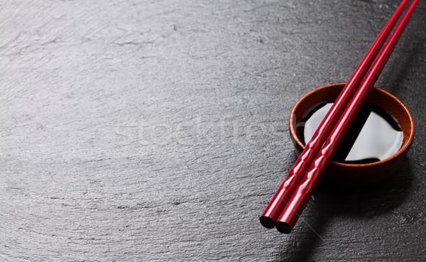 Japanese sushi bacchette salsa di soia ciotola nero Foto d'archivio © karandaev