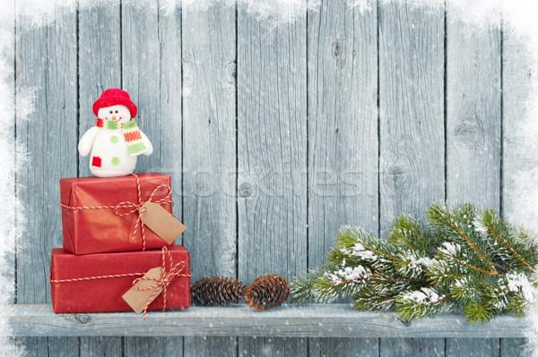 Karácsony ajándékdobozok fenyőfa ág fából készült fal Stock fotó © karandaev