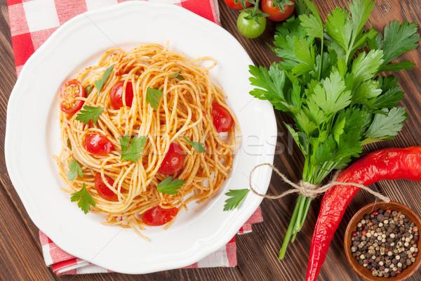 Spaghetti pasta tomaten peterselie houten tafel top Stockfoto © karandaev