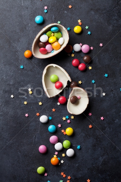 Colorful candies and chocolate egg Stock photo © karandaev