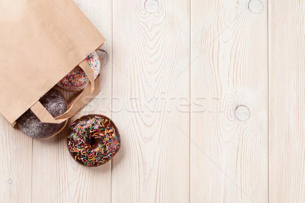 ストックフォト: ドーナツ · 紙袋 · 木製のテーブル · 先頭 · 表示 · コピースペース