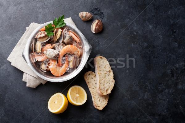 Fraîches fruits de mer pierre table haut vue Photo stock © karandaev