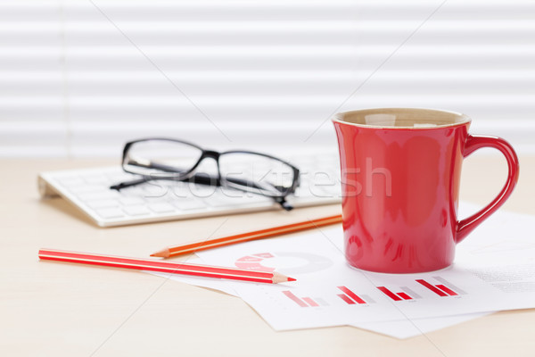 Office workplace with coffee and charts Stock photo © karandaev