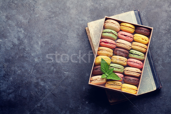 Stock photo: Colorful macaroons in a box over book