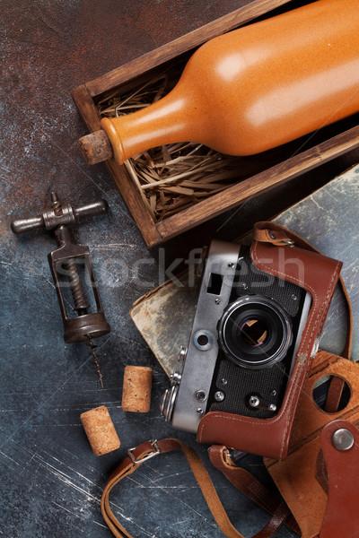 Wine bottle in box and vintage camera Stock photo © karandaev