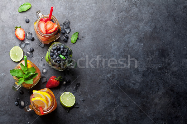 Fresh lemonade with summer fruits and berries Stock photo © karandaev