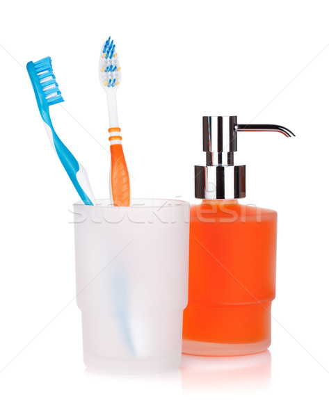 Two colorful toothbrushes and liquid soap Stock photo © karandaev