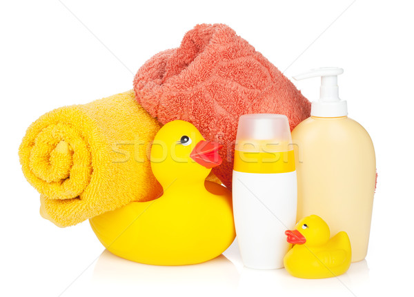 Rubber duck with bath towel and bottles Stock photo © karandaev