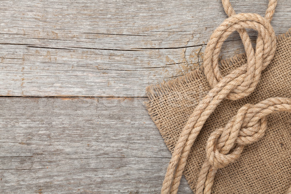 Ship rope on wooden texture background Stock photo © karandaev