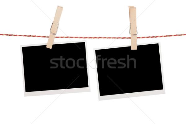 Blank photos hanging on clothesline Stock photo © karandaev