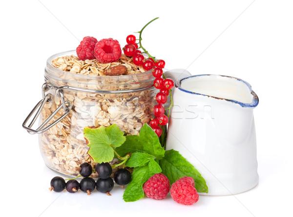 Colazione muesli frutti di bosco latte isolato bianco Foto d'archivio © karandaev