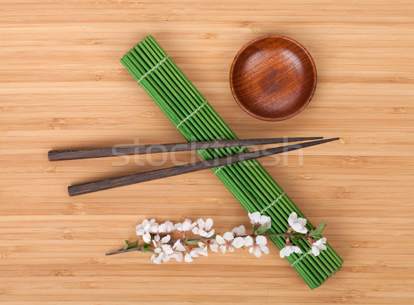 Chopsticks and sakura branch Stock photo © karandaev
