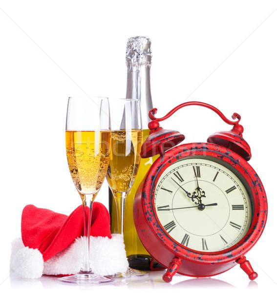 Two champagne glasses, santa hat, bottle and clock Stock photo © karandaev