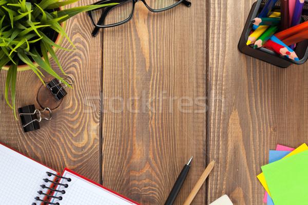 Iroda asztal virág jegyzettömb készlet felülnézet Stock fotó © karandaev