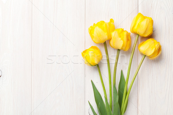Yellow tulips over wooden table Stock photo © karandaev