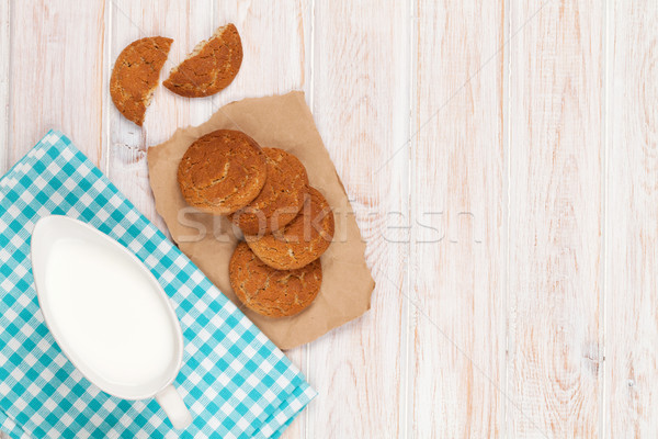 Milk pitcher and gingerbread cookies Stock photo © karandaev