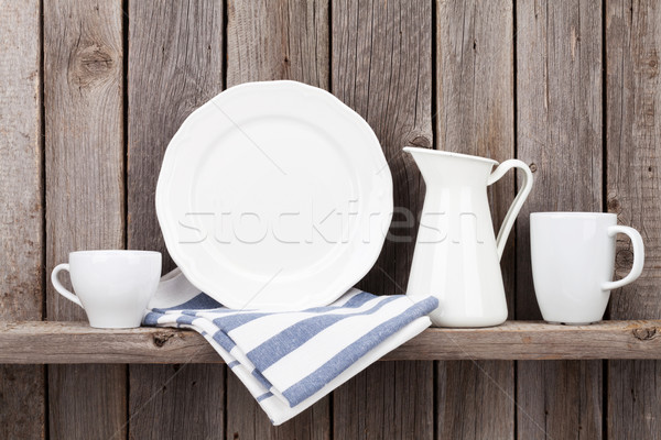 Kitchen utensils on shelf Stock photo © karandaev