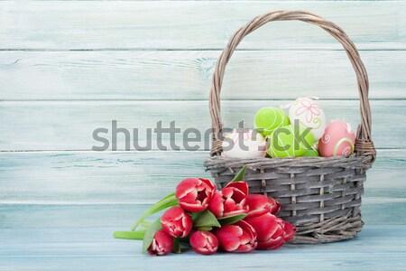 Húsvéti tojások kosár polc fából készült fal kilátás Stock fotó © karandaev