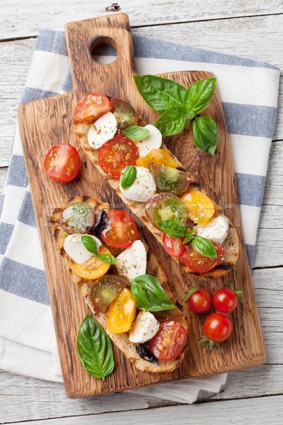 Stok fotoğraf: Bruschetta · domates · mozzarella · fesleğen · kiraz · domates
