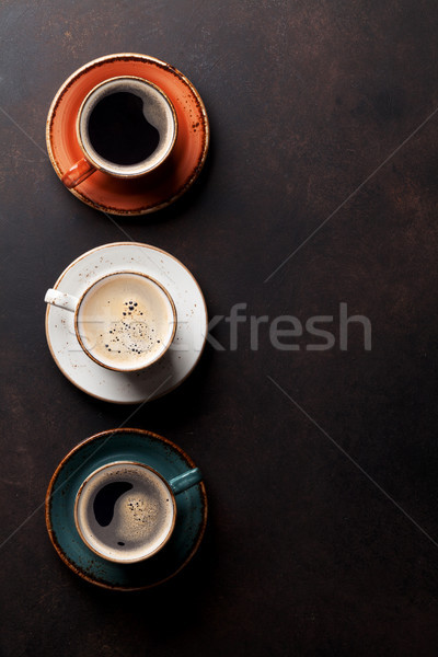 Coffee cups on old kitchen table Stock photo © karandaev