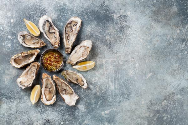 Fresh oysters Stock photo © karandaev