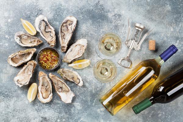Friss osztriga fehérbor kő asztal felső Stock fotó © karandaev