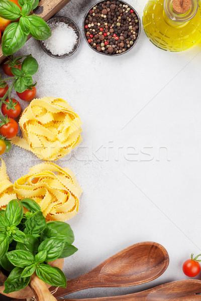 Fresh garden tomatoes and pasta on cooking table Stock photo © karandaev