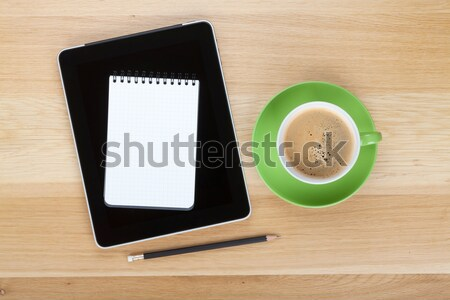 Stock photo: Touch screen tablet computer, notepad, pencil and cup of coffee