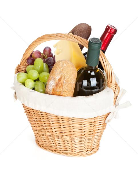 Piknik sepeti ekmek peynir üzüm şarap şişeler Stok fotoğraf © karandaev