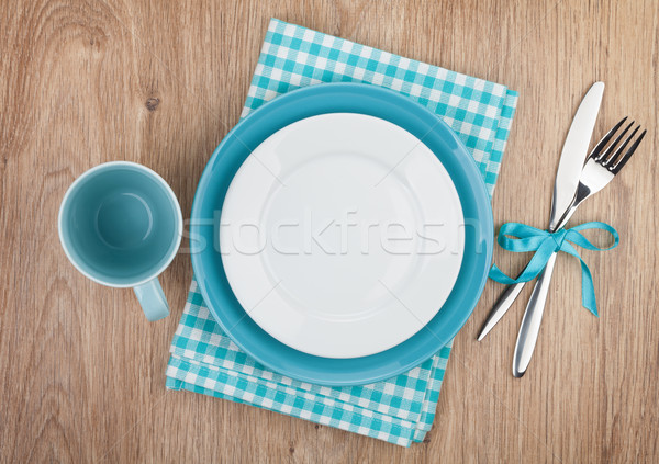 Stock photo: Fork with knife, blank plates and napkin