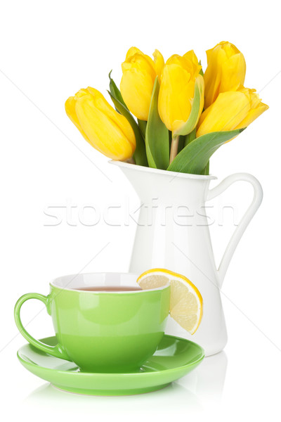 Yellow tulips and tea cup with lemon slice Stock photo © karandaev