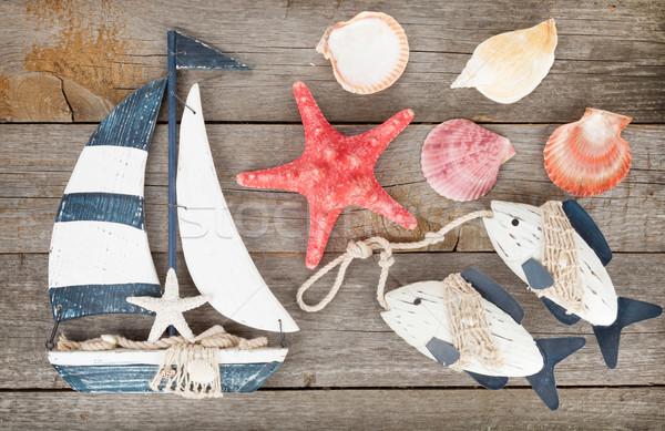 Giocattolo vela pesce conchiglie starfish legno Foto d'archivio © karandaev