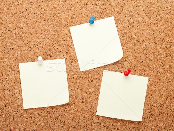Blank postit notes on cork notice board Stock photo © karandaev