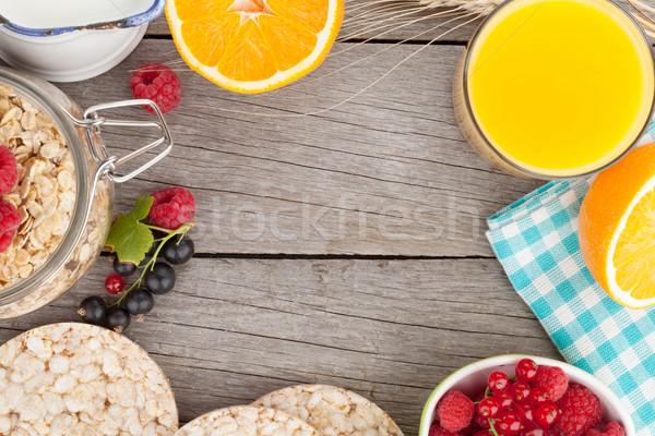 Stock photo: Healty breakfast with muesli, berries and orange juice