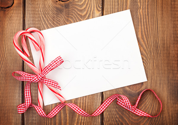 Christmas greeting card or photo frame over wooden table with ca Stock photo © karandaev